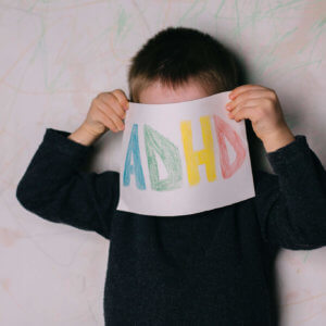 ADHD Sign Held by Little Boy